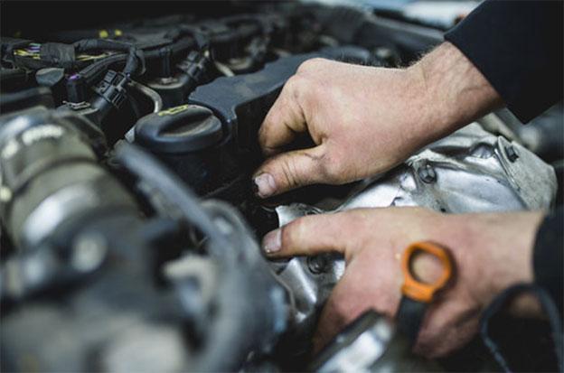 mechanic repairing ignition