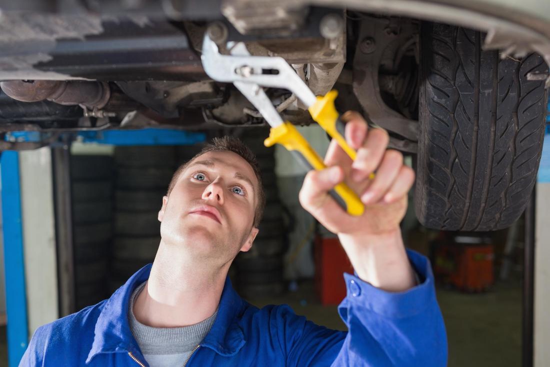 Mechanic under a car
