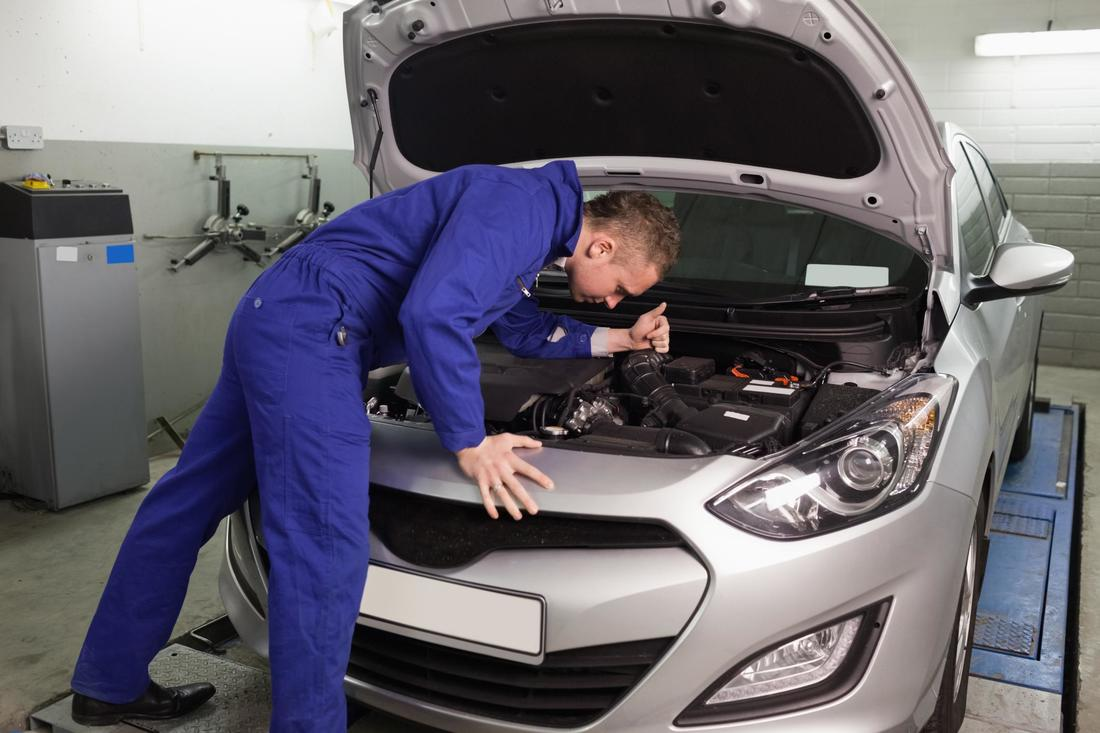 mechanic checking under the hood